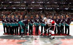 Members of the 1993-1994 Anaheim Ducks stand on the ice for a ceremonial puck drop between the Anaheim Ducks and Ottawa Senators. #MightyDucks #ThrowbackNight