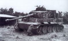A Brit measures the width of a track on a Tiger 2 from the schwere SS-Panzer-Abteilung 102.