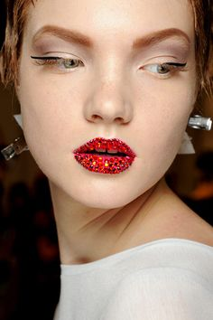 Dior Couture Beauty by Pat McGrath via www.beautyandthedirt.co.uk    Bright, strong lipstick with individually placed Swarovski crystals