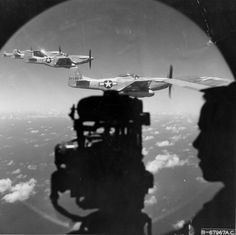 P-51 'Mustang' of 458 th Fighter Squadron on board the B-29 bomber 'Sverhkrepost' during the flight to bomb targets in the Japanese metropolis.