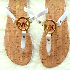 Michael Kors White Jelly Sandal Authentic Michael Kors black jelly T strap sandals. White straps with white bottoms. It has gold hardware MK logo on it. Cork bed perfect for the beach. It still has the stickers size on it. Please no trading. PRICE IS FIRM unless it's bundled. I give bundle discount. Michael Kors Shoes Sandals