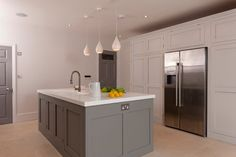 Handle-less Shaker Kitchen. Walls and cupboards French Grey Pale, Island Mid Lead, Little Greene.