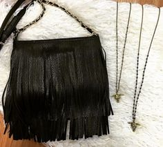 What's better than {fringe} cross-body's & bull necklaces!? ✨ Shop these items in stores only. #shopPD