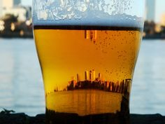 This is a beautiful photo a city skyline shot through a glass of #Beer. Real or #photoshop? What city? Either way, it's beautiful.