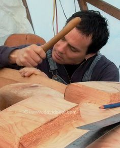 Kwakiutl artist David Neel carving a totem pole from red cedar in North Vancouver, Canada