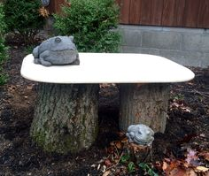 Two tree logs an old piece of marble and two frog friends equals a repurposed garden seat.