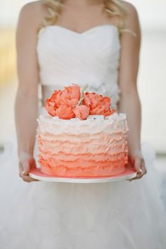 Orange, Coral Ombre wedding cake with ruffles.