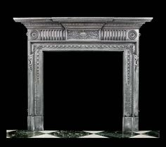 A Victorian cast iron fireplace in the Neoclassical style with a break front shelf above an egg and dart fringe, the stop fluted frieze centred by a pretty urn and a foliate decorated plaque, flanked by bullseye end blocks and with trailing bell flowers surrounding the opening.  English, 1880.