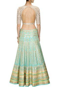 This Aqua color Bridal Lehenga Choli is featuring in georgette fabric embellished with traditional gota patti embroidery. This Aqua color Bridal Lehenga Choli i