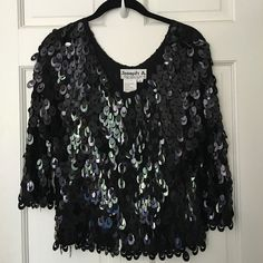 Silk Party Sequined Crop Top Gorgeous  crop top by Joseph A. 100% silk shirt covered in dangly shiny pailettes. Awesome dressed up as evening wear but cute over ripped jeans and stacked heels too. #black #croptop #shiny #sparkly #Musthave #spring #essential #trending #European #chic  #trendy #blogger #allback #basicblack #fashion #fashionista #Datenight #goingout #sexy Joseph A Tops Crop Tops