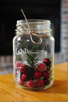 Mason Jar Holiday Candle Holder w/cranberries, a sprig of pine, and a votive cup. Finish with a bit of twine. #DIY #Christmas
