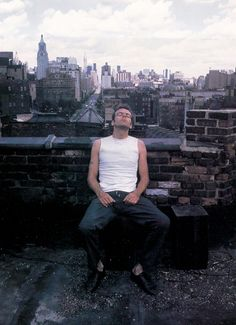 Nan Goldin, Brian on the roof. I believe she shot slide film?