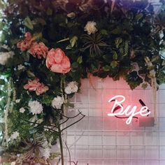 Bye Felicia neon sign with hanging roses