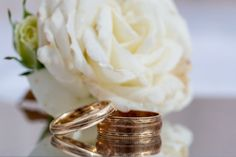 Close up of wedding rings with a rose corsage Rose Corsage, Photography Portfolio, Patches, Wedding Photography, Wedding Rings, Engagement Rings, Enagement Rings, Wedding Photos, Diamond Engagement Rings