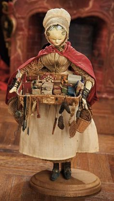 * Early Grodnertal Wooden Peddler Doll with Basket of Novelties circa 1830.