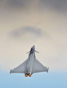 Wings in the sky A Royal Air Force Typhoon performing an air display at RAF Coningsby.