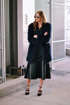 Leather midi skirt with oversized coat bold up a monochromatic ensemble #StreetStyle