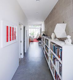 corridor - white wall, offset by white cabinets in front of the concrete wall