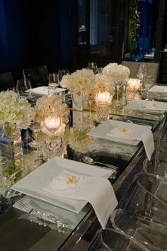 When paired with sultry blue lighting, light blooms with glass and crystal place settings illuminate the dining table. Read more for Decorating A Seasonal Table. Wedding Table Decorations, Decoration Table, Enchanted Home, Beautiful Table Settings, Elegant Table, Deco Table, Holiday Tables, Event Decor, Tablescapes
