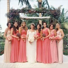 coral bridesmaid dresses #bridesmaids #ombredresses #weddingchicks http://www.weddingchicks.com/2014/01/20/party-light-wedding/