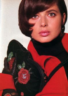Isabella Rossellini, American Vogue, September 1985. Photograph by Eric Boman; handbag: Fendi.