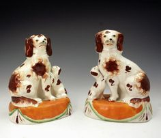 Antique Staffordshire spaniels and begging pups