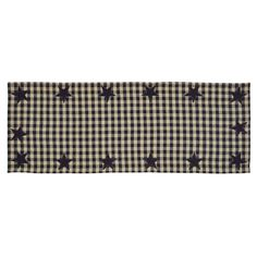 """The Black Star Placemat isblack and khaki check. It measures 13x36"""" and features appliqued stars all the way around the edge. 100% cotton fabric."""
