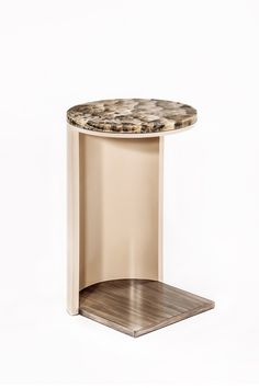 This Side Table features a round onyx stone top.