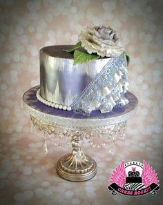 I Feel Pretty, Oh So Pretty!  Purple, silver & white cake with cake lace & luster finish.