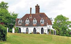 Houghton Lodge, Stockbridge, Hampshire  Houghton Lodge is an 18th-century cottage ornée built originally as a fishing lodge.