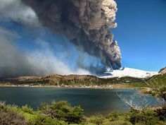 Lava Flows and Restless Giants in Latin America | View of the Copahue volcano spewing ashes behind the lagoon of Caviahue, Neuquen province, Argentina. | Credit: AFP/Getty Images | From Wired.com