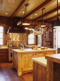 Not a fan of this kitchen, but I've got to have one of those above a center island if I ever have one. Eclectic kitchen by Tucker & Marks