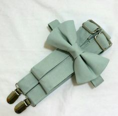 Sage Green Suspenders and Sage Bow Tie. Perfect for your Groomsmen, Ring Bearer, Best Man, and Groom. Free Fabric Sample Available. Groomsmen Suspenders, Fall Groomsmen, Chambelanes, Green Bow Tie, Sage Green Tie, Bow Tie Wedding, Wedding Suits, Wedding Tuxedos, Dream Wedding