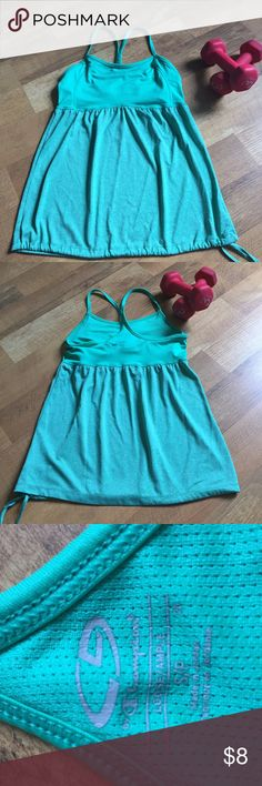💕Great workout racer back tank Champions racer back tank top with shelf bra. Loose fitting with a tie at the bottom. Very comfortable fit. 💪 Champion Tops Tank Tops