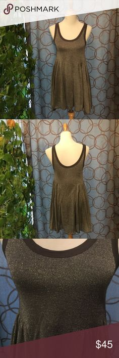 Free People Beach Grey Glitter Tank Dress Small Free People Beach Grey Glitter Tank Dress. Size Small. Excellent used condition. Fully lined. Shell: 47% polyester, 25% rayon, 17% nylon,11% lurex; lining: 100% rayon. Measurements approximate. Bust 26 in. Waist 28 1/2. Hips 35 in. Length center of dress to hem 24 1/2 in. Very stretchy- shown on my size Medium dress form. Not quite as dark as shown in pics. Edging at top is a dark grey. Free People Dresses Mini