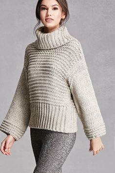 095eb21f3e A chunky wool-blend sweater featuring a cowl neckline with a side slit