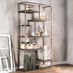 Add a metallic accent to your home with this statement bookcase. Choose from chrome or champagne to enhance the shined metal framework while the six espresso finished shelves offer room to display your treasured decor.