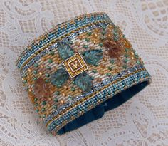 Needlepoint Wrist Cuff - Elegant Pale Teal and Gold Embellished Needlepoint Wrist Cuff - Size 7.0 (W519). $165.00, via Etsy.