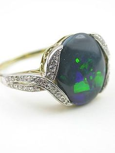 Ring | Designer ? c. 1895 (late Victorian).  14kt green gold, diamonds and oval cabochon cut opal.