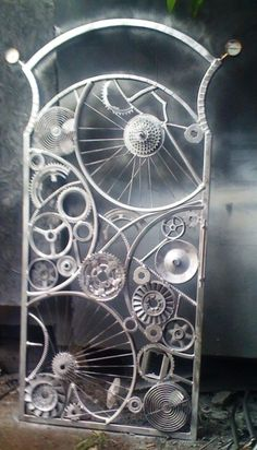Steam punk gate, this would look even better if it was painted with bronze paint. #DIY #Steampunk #Backdrop