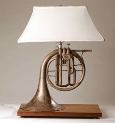 Made this lamp for my music room a few years ago. Used French horn from local … Made this lamp for my music room a few years ago. Used French horn from local antique store, old walnut plank and a shade from an old lamp that I had. Made the base to mirro Old Musical Instruments, Horn Instruments, Old Lamps, French Horn, Antique Stores, Lampshades, Decoration, Lamp Light, Light Fixtures