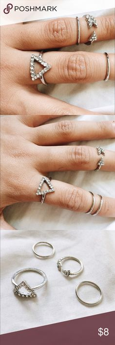 Ring Collection: Forever Δ's Cute little ring collection of 4. Finger rings are size 3/4. Two are the classic silver band and the other is an diamond arrow. The actual bigger ring (Delta) ring is a diamond delta, perfect gift for your big/lil sorority sis or friend! Feel free to ask me any questions💗 the larger delta ring is a size 6! NOT UO, just used for exposure. Urban Outfitters Jewelry Rings