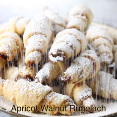 This is perhaps the easiest rugelach recipe you'll ever come by. Each flakey lay… This is perhaps the easiest rugelach recipe you'll ever come by. Each flakey layer is loaded with apricot jam and chopped walnuts. Baking Recipes, Dessert Recipes, Pastries Recipes, Bread Recipes, Italian Pastries, Italian Cookies, Italian Cookie Recipes, Jewish Recipes, Dessert Bread