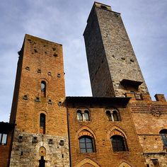 The famous towers in the village of San Gimignano // Siena, Tuscany, Italy