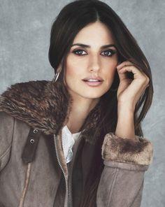 Furry Hood, Bomber Jacket, Sleek Straight Hair, Browns and Golds Eye Make-Up; Penelope Cruz.