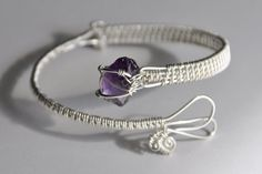 Wire Wrapped Bangle Bracelet, Sterling Silver, Purple Rough Cut Amethyst Gemstone, Adjustable. $50.00, via Etsy.
