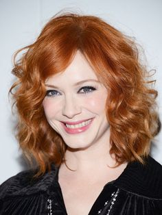 Famous Actress Christina Hendricks with her Curly-And-Fiery-Red Hairdo.