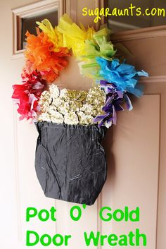 Pot O' Gold door décor. Wreath for St. Patrick's Day DIY with recycled materials. By Sugar Aunts
