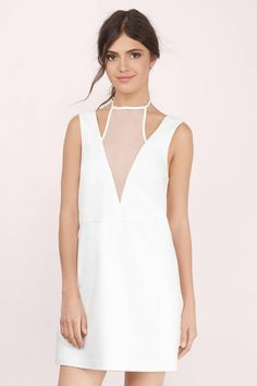 This white halter shift dress will turn heads when you walk into the room with it on. Wear with statement jewelry and your favorite heels to complete the look.