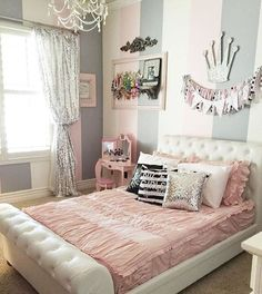 An upholstered bed is perfect for all ages! Love the soft pink and grey tones!